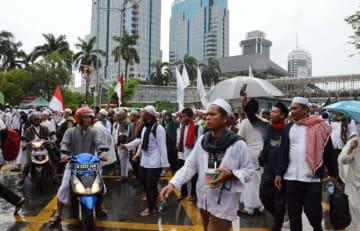ジャカルタの目抜き通りで行われたデモのようす(NNA撮影)