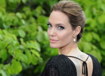 Angelina Jolie Talks Divorce from Brad Pitt: LONDON, ENGLAND - MAY 08: Angelina Jolie attends a private reception as costumes and props from Disney's 'Maleficent' are exhibited in support of Great Ormond Street Hospital at Kensington Palace on...