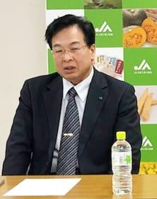 新組合長に就任して記者会見する宮田氏