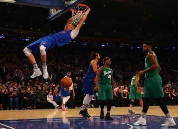 NEW YORK, NY - DECEMBER 25: Kristaps Porzingis #6 of the New York Knicks dunks the ball against the Boston Celtics at Madison Square Garden on December 25, 2016 in New York City. NOTE TO USER: User expressly acknowledges and agrees that, by...