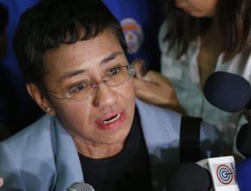 保釈されたジャーナリストのマリア・レッサ氏=14日、マニラ(AP=共同)
