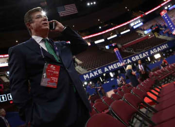 CLEVELAND, OH - JULY 17: Paul Manafort, Campaign Manager for Donald Trump, speaks on the phone while touring the floor of the Republican National Convention at the Quicken Loans Arena as final preparations continue July 17, 2016 in Cleveland,...