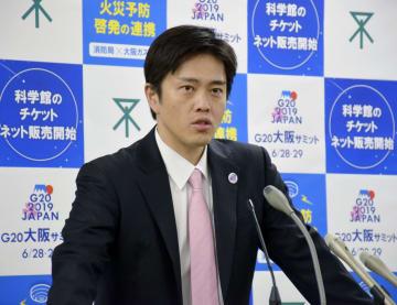 記者会見で自動車レースF1の開催意向を示す吉村洋文大阪市長=21日午後、大阪市役所