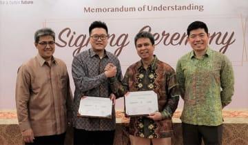「BSDシティー」のスマートシティー開発事業で、協力契約を締結したシナールマス・ランドとグラブ・インドネシアの関係者(同社提供)