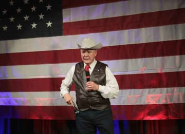 FAIRHOPE, AL - SEPTEMBER 25: Republican candidate for the U.S. Senate in Alabama, Roy Moore, displays a pistol to express his support for Second Amendment as he speaks at a campaign rally on September 25, 2017 in Fairhope, Alabama. Moore is...