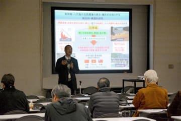 球磨川河口の生物多様性やラムサール条約をテーマに開かれたシンポジウムの会場=八代市