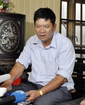 取材に応じるドアン・ティ・フオン被告の父、ドアン・バン・タインさん=14日、ベトナム北部ナムディン省(共同)