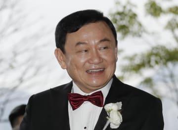 22日、香港のホテルで自身の娘の結婚披露宴に出席したタクシン元首相(AP=共同)