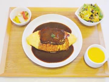 赤ワインとデミグラスソースで煮込んだ牛タンをのせたオムライス(税込み1300円)=新座市の「ビストロ・KUROKAWA」