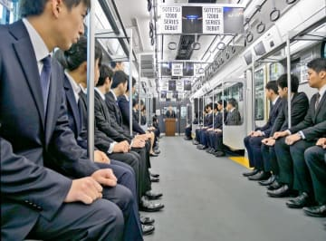 JR線との相互直通運転に使われる新型車両の中で行われた相模鉄道の入社式=海老名市、かしわ台車両センター