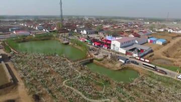 環境保護の理念で中国農村部の伝統的習慣を再構築