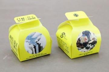 「花卉双鶏図」(右)と「瀑布四題」がデザインされた特別包装の「大手まんぢゅう」