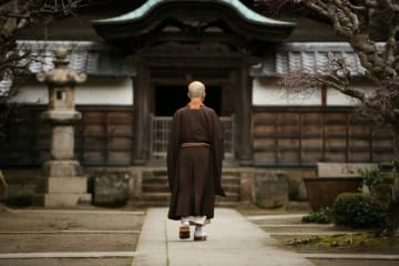A Buddhist monk in the courtyard of a monastery in Kamakura.