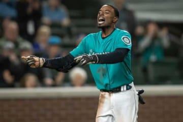 暴投で二塁から生還をしたマリナーズのディー・ゴードン【写真:Getty Images】