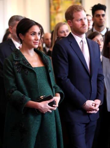 3月11日、ロンドンでイベントに出席した英国のメーガン妃とヘンリー王子(ロイター=共同)