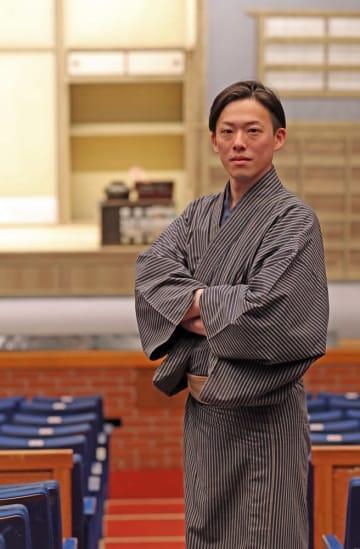 「挫折から立ち直ることで成長する」と語る忠村臣弥さん=長崎市民会館