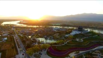 美しい中国を建設し、共に緑の世界を築く