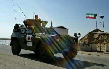 自衛隊のイラク派遣 (2004年1月19日)ロイター/アフロ