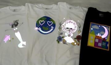 学生がデザインした手描きイラストの反射材Tシャツ。光を当てると模様が浮き出て見える