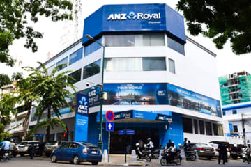 Japanese financial firm J Trust Co. will delay the planned takeover of ANZ Royal Bank (Cambodia) Ltd., a major Cambodian commercial bank, until the July-September quarter.