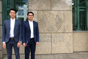 This handout courtesy of Ray Wong taken in June 2018 and released on May 22, 2019 shows activists Ray Wong (L) and Alan Li posing for a photo in Berlin. Photo: AFP Handout.