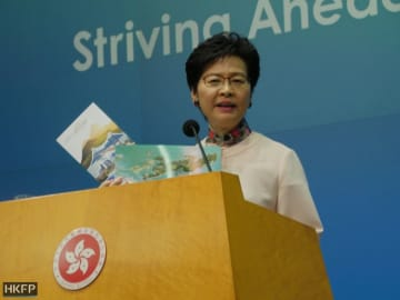 Carrie Lam showing her plan for reclamation off East Lantau. Photo: Holmes Chan/HKFP.