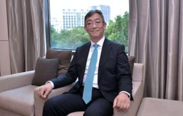 交流会に先立ち、ベトナム事業支援の方針を語った商工中金の佐藤常務執行役員=24日、ホーチミン市