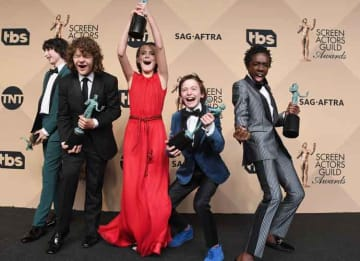 LOS ANGELES, CA - JANUARY 29: (L-R) Actors Finn Wolfhard, Gaten Matarazzo, Millie Bobby Brown, Noah Schnapp, and Caleb McLaughlin co-recipients of the Outstanding Performance by an Ensemble in a Drama Series award for 'Stranger Things,' pose in...