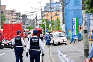 男性らが倒れていたとされる現場=川崎市多摩区、28日、午前9時50分ごろ