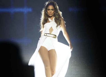 SINGAPORE - SEPTEMBER 21: Jennifer Lopez performs live following the Singapore F1 Grand Prix 2014 on September 21, 2014 in Singapore, Singapore. (Photo by Kamal Sellehuddin/Getty Images)