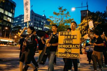 Jeffrey Ngo (left) protesting in Washington DC on October 1, 2014. Photo: Supplied.