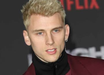 Machine Gun Kelly attends Premiere of Netflix's 'Bright' - Arrival: Premiere of Netflix's 'Bright' held at the Regency Village Theatre - Arrivals