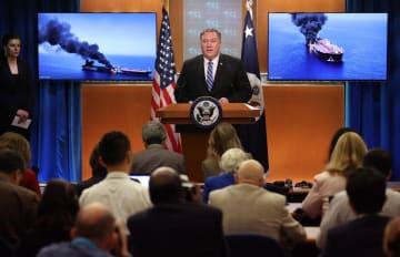 13日、ホルムズ海峡でのタンカー攻撃を受けて米ワシントンの国務省で記者会見するポンペオ国務長官(ゲッティ=共同)