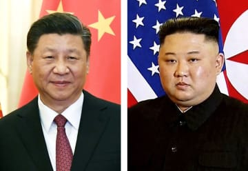 中国の習近平国家主席、北朝鮮の金正恩朝鮮労働党委員長(AP=共同)