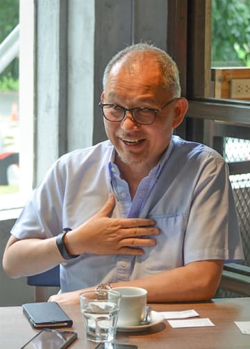 Hubert Young speaks in an interview with NNA in Manila on June 10, 2019, about Japanese burger chain operator Mos Food Services Inc.'s first outlet in the Philippines slated for 2020. (NNA/Kyodo)
