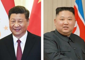 中国の習近平国家主席(左)、北朝鮮の金正恩朝鮮労働党委員長(朝鮮中央通信=共同)