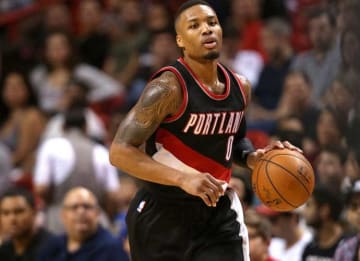 MIAMI, FL - DECEMBER 20: Damian Lillard #0 of the Portland Trail Blazers brings the ball up the floor during a game against the Miami Heat at American Airlines Arena on December 20, 2015 in Miami, Florida. NOTE TO USER: User expressly...