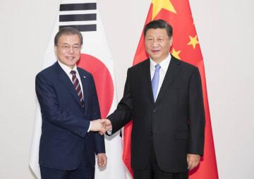 習近平主席、韓国大統領と会見 開放型世界経済の構築強調