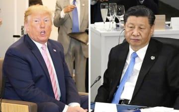 トランプ米大統領(左、代表撮影)と中国の習近平国家主席=28日、大阪市