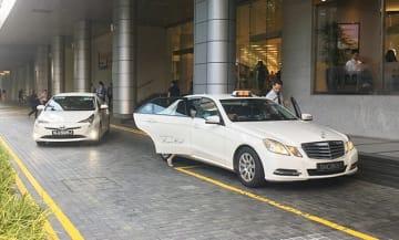 シンガポールで15日から、タクシーなどの運転手や事業者は、車両内で映像だけでなく音声の記録が可能になる=2日、シンガポール中心部(NNA撮影)