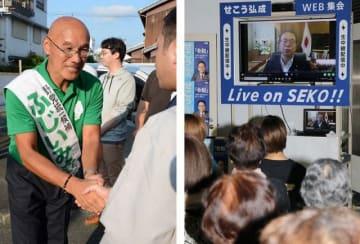 街頭演説の後、有権者と握手する藤井幹雄氏(左)=田辺市で、ウェブを通じ政策を訴える世耕弘成氏=右=和歌山市で