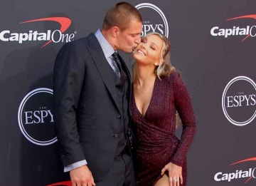 Rob Gronkowski & Girlfriend Camille Kostek Share Cheeky Kiss At The ESPY'S