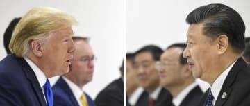 会談するトランプ米大統領(左)と中国の習近平国家主席=6月29日、大阪市(AP=共同)