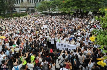 "The banner leading the march reads: ""Support the young, protect Hong Kong."" Photo: May James."