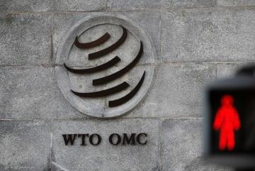 スイス・ジュネーブのWTO本部のマーク=2018年10月(ロイター=共同)
