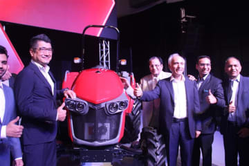 Officials of Japanese farm equipment manufacturer Yanmar Holdings Co. and its Indian partner International Tractors Ltd. pose with a newly launched Yanmar tractor in New Delhi on July 10, 2019. (NNA/Kyodo)