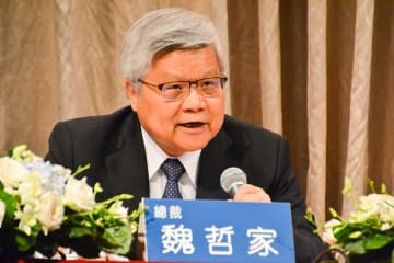 TSMC chief executive and vice chairman C. C. Wei briefs reporters on second quarter earnings in Taipei on Thursday.