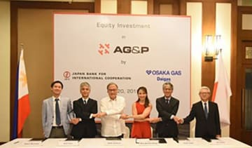 Senior officials from Japanese utility Osaka Gas Co., government-backed Japan Bank for International Corp. and Singapore's engineering firm AGP International Holdings Pte. Ltd. pose at a signing ceremony for an investment and business alliance agreem