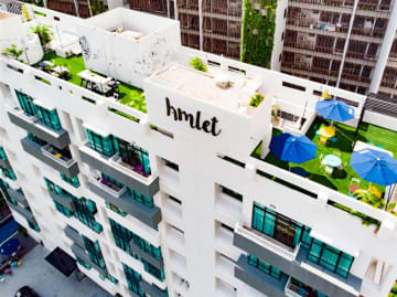 A co-living housing building managed by Singapore's Hmlet accommodates a rooftop shared space. (Photo courtesy of Hmlet)