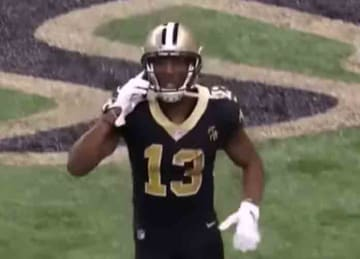 Saints' Michael Thomas celebrates TD with flip phone call